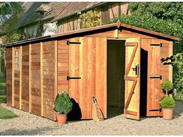 Garage bois panneau trait brun id752 contact france abris for Garage bois traite