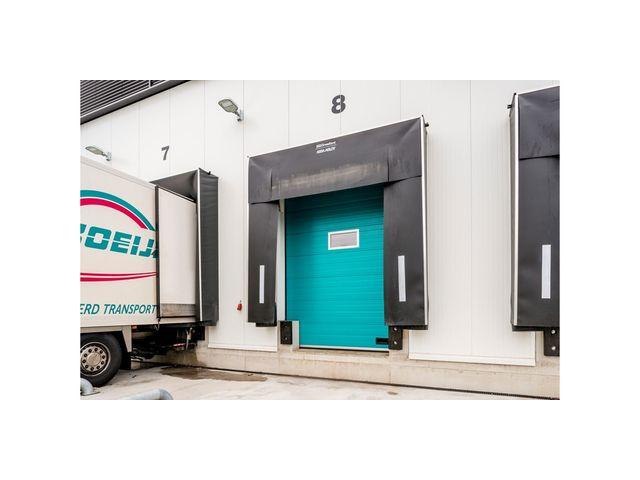 Porte sectionnelle haute isolation contact assa abloy entrance systems - Porte sectionnelle crawford ...