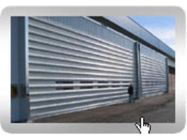 Rideau metallique contact fermetal for Porte de garage rideau occasion