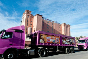 Vue d'ensemble des Grands Moulins du Tensift à Marrakech avec les remorques aux couleurs de la marque MayMouna